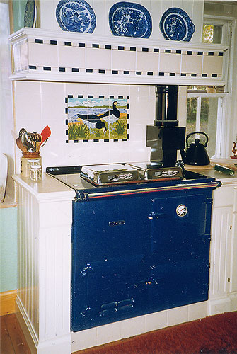 Rayburn cooker with Geese tile panel