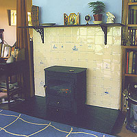 handpainted fireplace tiles behind stove